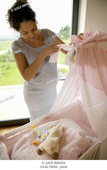 Woman getting baby's room ready