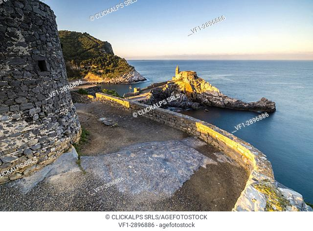 Sunrise on the old castle and church perched on the promontory Portovenere province of La Spezia Liguria Italy Europe
