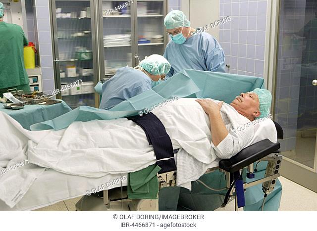 Vascular surgery, surgery on the hand with local anesthesia, operating room in the hospital, Düsseldorf, North Rhine-Westphalia, Germany