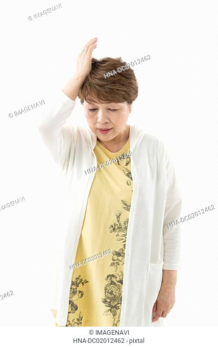 Senior woman recollecting