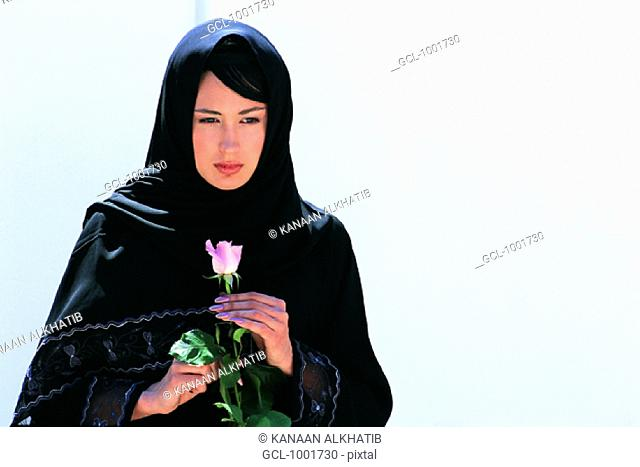 Woman with rose in her hands