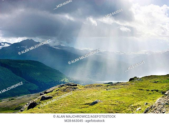 Rain squall in the Chugach Mountains near Thompson Pass, Alaska, USA