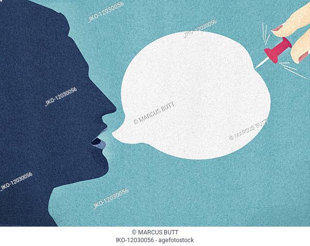 Woman's hand bursting man's speech bubble with pin