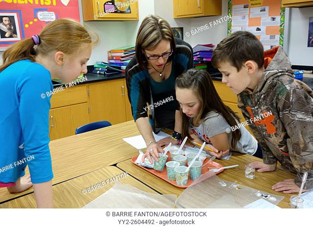 Teacher and Students Studying Chemical Reactions, Wellsville, New York, United States
