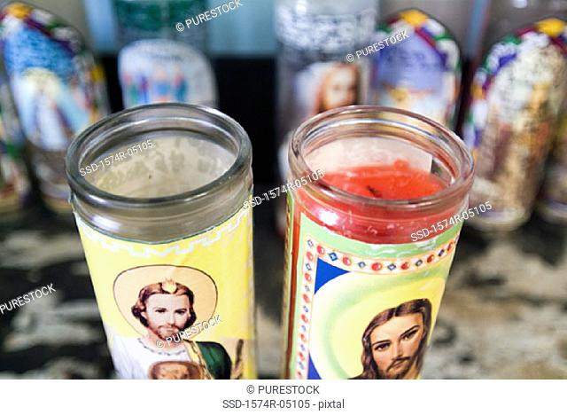 Close-up of religious candles