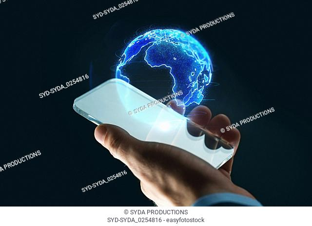 hand with smartphone and earth hologram