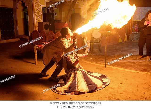 Indian man fire breathing over Indian woman
