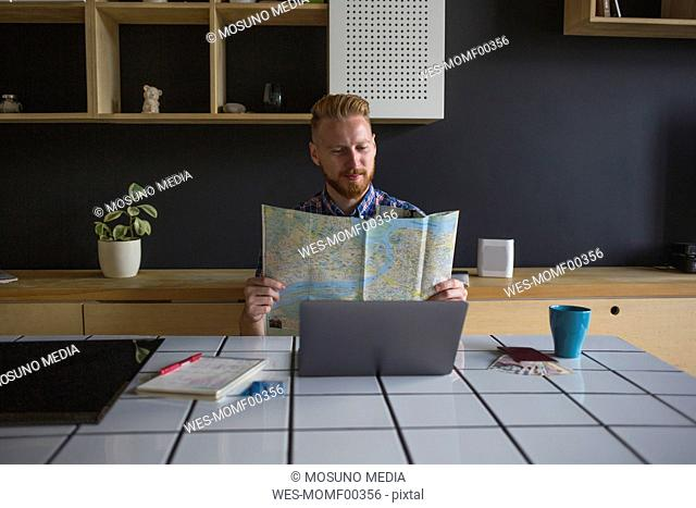 Man planning a trip at home
