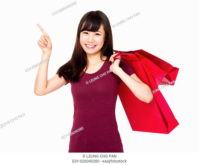 Asian Woman hold with present box and finger point up