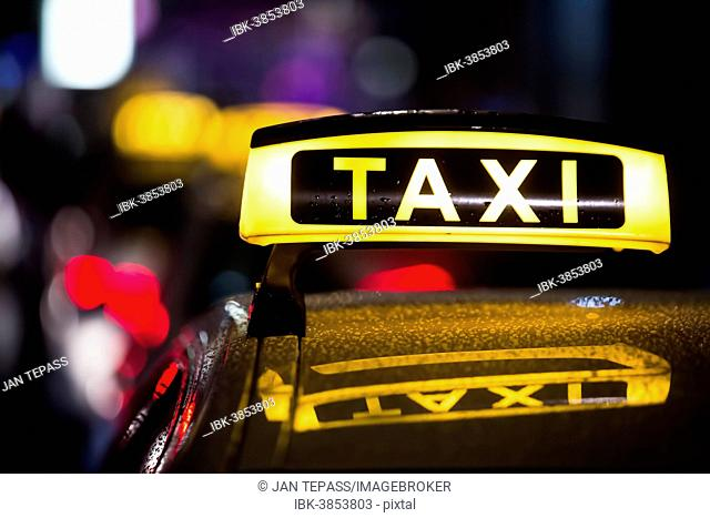 Taxi in the rain at night, Cologne, North Rhine-Westphalia, Germany