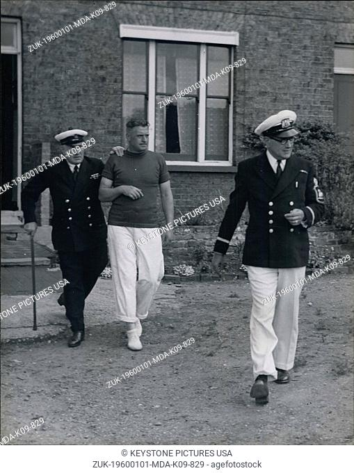 Jan. 01, 1960 - Mr. F.T. Turk, the Queen's Swan Keeper (left) and Mr. L.J. Robinson, the Dyers' Co. Swan Master, going out to the boats for the annual ceremony...