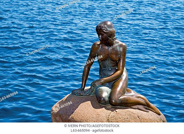 Little Mermaid bronze sculpture by Edward Eriksen erected in 1913 and based on the character created by Hans Christian Andersen. Copenhagen. Denmark