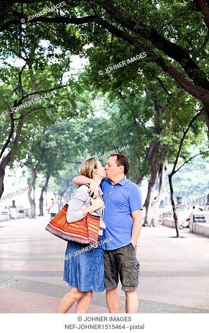 Couple kissing in park