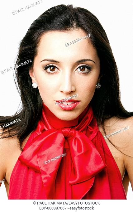 Face of a beautiful happy Caucasian Hispanic woman with red satin bowtie shirt and red lipstick, isolated