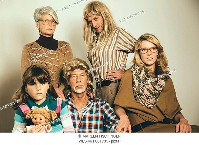 Portrait of family dressed like in the Eighties