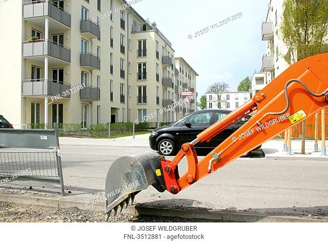Digger at residential neighborhood in Munich, Germany