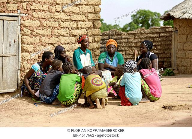 Women sitting in a circle having a conversation, Toeghin village, Oubritenga province, Plateau Central region, Burkina Faso
