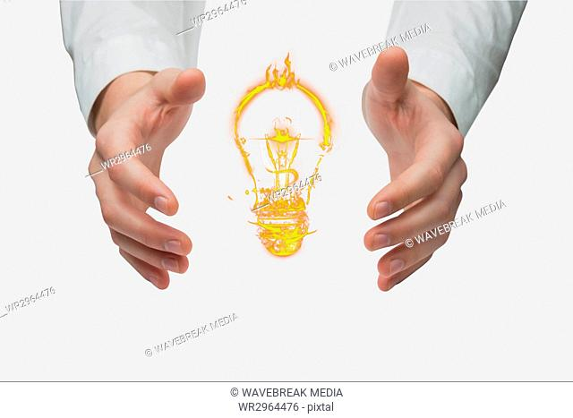 bulb on hands against white background