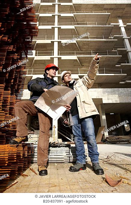 Architect and construction worker, personal protective equipment, housing construction, concrete skeleton