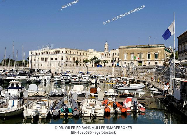 Sailing boats in the harbor and church Chiesa del Carmine, near the sea, Trani, Apulia or Puglia, South Italy, Europe