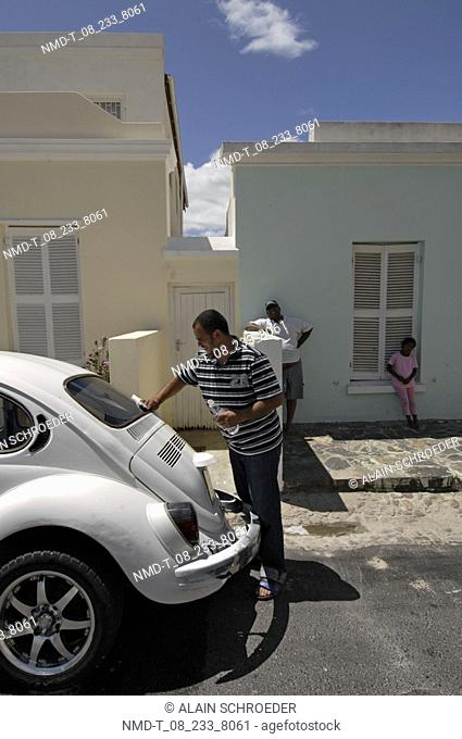 Side profile of a mid adult man cleaning a car, Bo-Kaap, Cape Town, Western Cape Province, South Africa