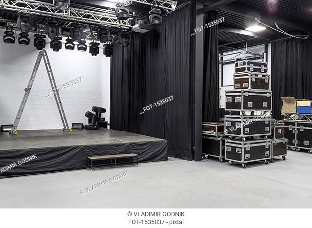 Step ladder on stage by curtains at studio