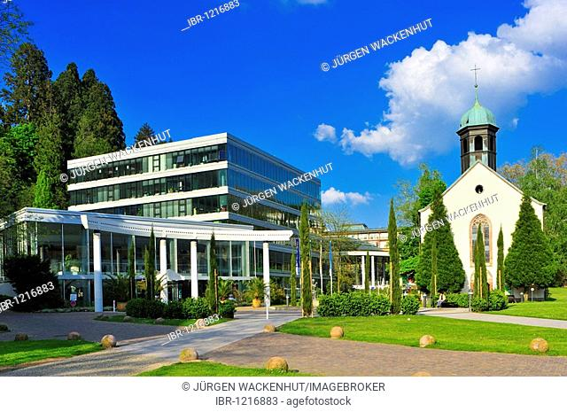 Caracalla-Therme hot springs and public swimming pool with Spitalkirche church, Baden-Baden, Black Forest, Baden-Wuerttemberg, Germany, Europe