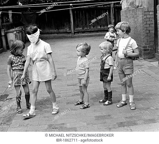 Children playing blind man's buff, Leipzig, East Germany, about 1976