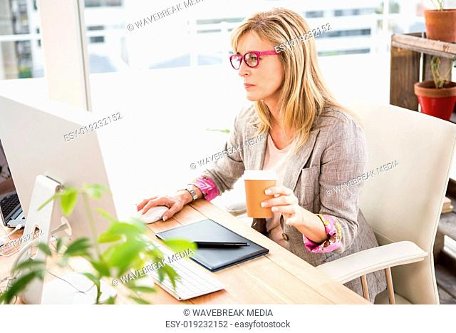 Casual designer working on computer