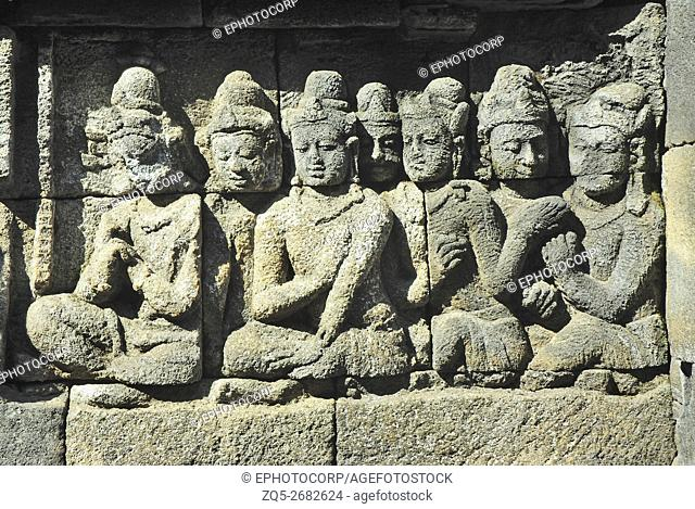 Indonesia-Java, Borobudur, Devotees sitting in front of Lord Buddha (not in picture)