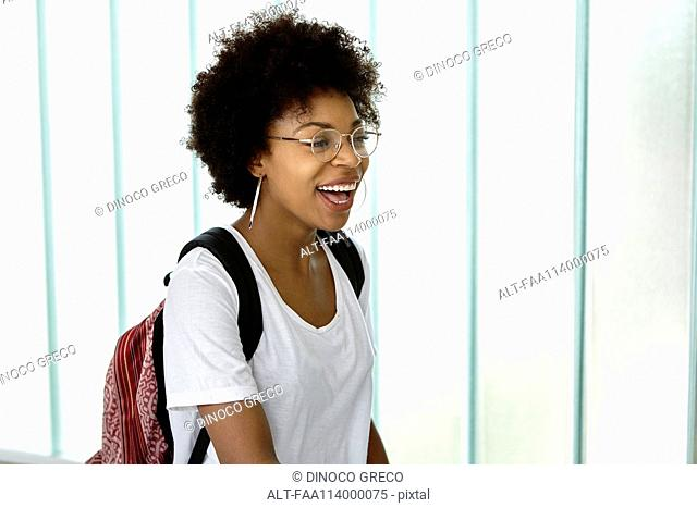 Young woman carrying backpack