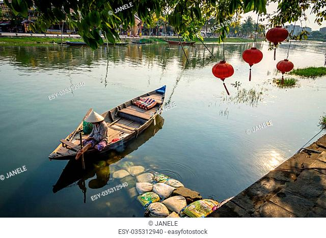 Vietnamese Woman on a wood boat. Hoi An