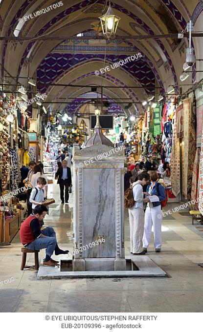 Fatih, Sultanahmet, Kapalicarsi, Man washing his feet in the Grand Bazaar