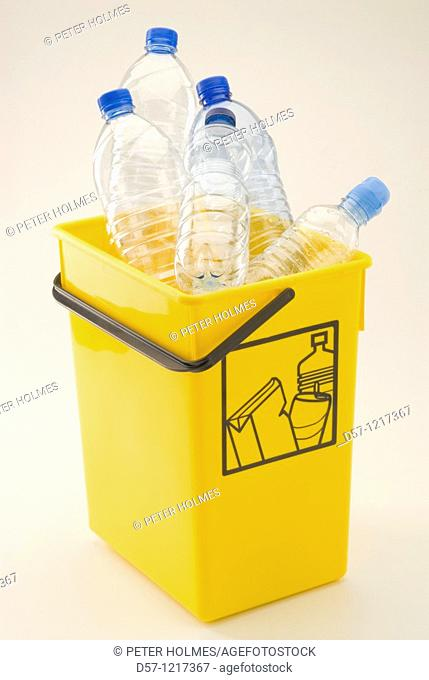 Yellow recycling bin for plastic and aluminum