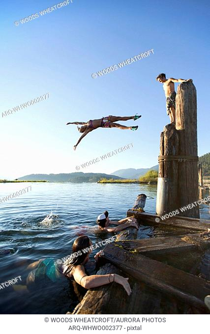 A group of friends jumping and playing in the water. Lake Pend Oreille, Sandpoint, Idaho