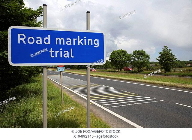 road marking trial roadsign and markings on dual carriageway county antrim northern ireland uk