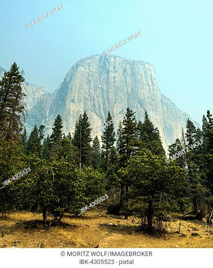 El Capitan in smoke from a forest fire, Yosemite National Park, UNESO World Heritage Site, California, USA