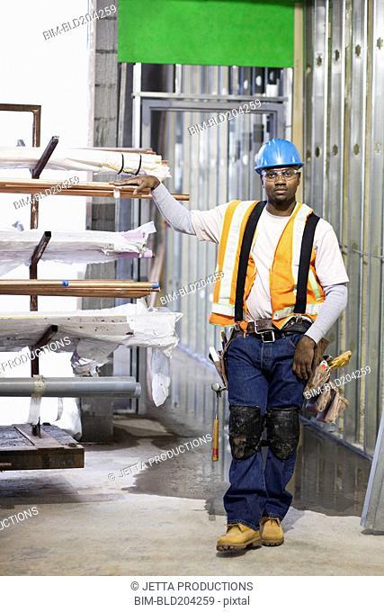 African American worker organizing metal on site