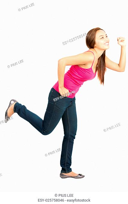 Isolated white background profile view of a beautiful Asian woman casually dressed while smiling, looking away and exaggerated running