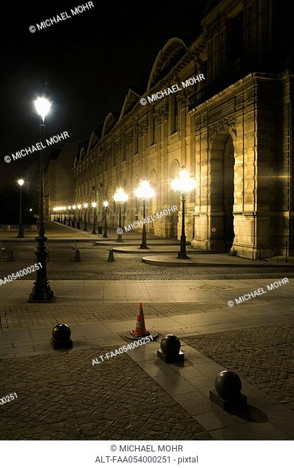 France, Paris, exterior of The Louvre illuminated at night
