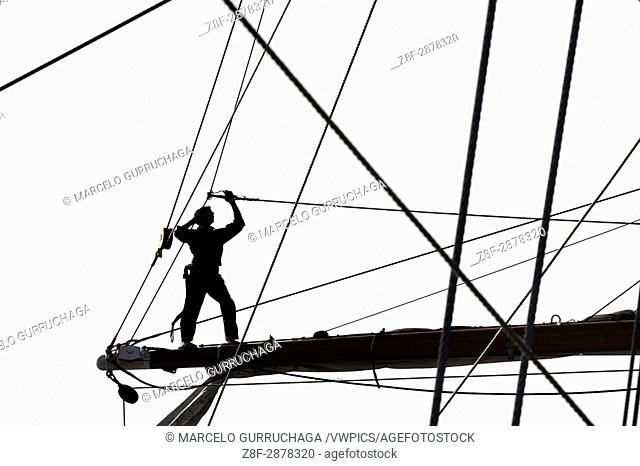 Libertad Ship at port, sailor working with ropes and sails