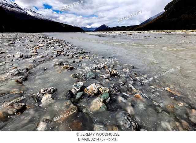 Rocky river under mountains, Glenorchy, Central Otago, New Zealand