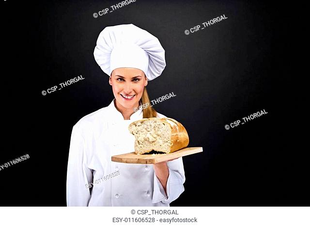 Chef baker smailing, fresh baked bread