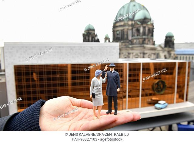 A miniature model of the Palace of the Republic with a model of a Trabant and figurines of Margot and Erich Honecker on a viewing platform looking out onto the...