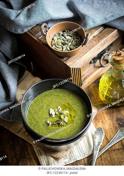 Spinach sweet potato cream soup on a wooden background