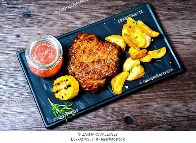 juicy pork Steak with potatoes and vegetables