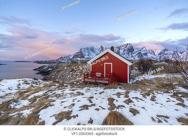 Traditional fishermen house in winter at dawn. Hamnoy, Nordland county, Northern Norway, Norway