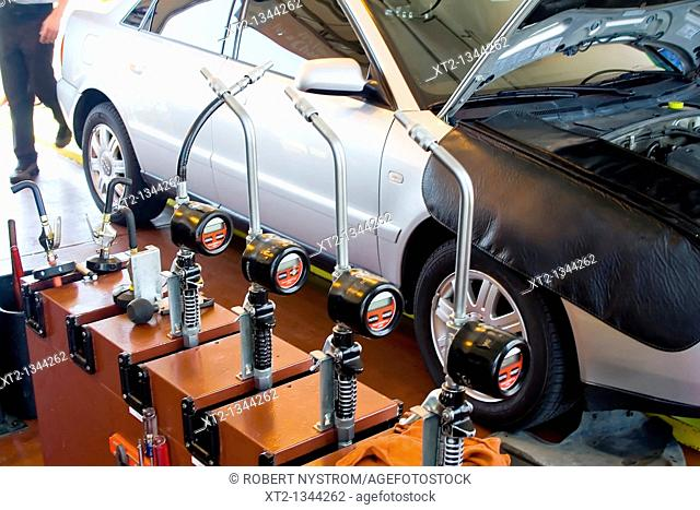 Car in a mechanic shop being serviced