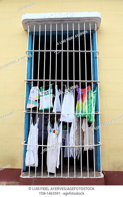 Typical window of the historic city of Trinidad and sale of clothing, Cuba