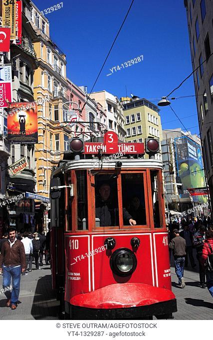 Old Tram travelling along Istiklal Caddesi street, Beyoglu, Istanbul, Turkey